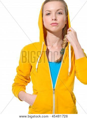 Portrait Of Serious Teenager Girl In Sweater With Draped Hood