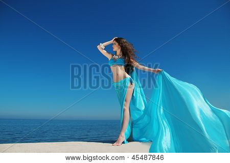 Enjoyment - Free Sexy Woman Enjoying Happiness. Beautiful Woman In Blue Chiffon Dress Embracing With