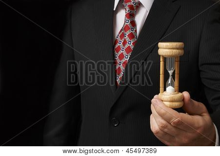 Businessman Holding Hourglass