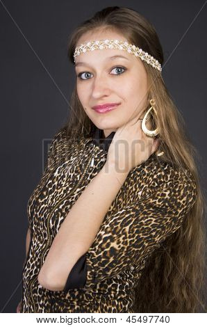 Beautiful young girl in a leopard print dress