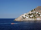 image of hydra  - The small vessel swimming out from the harbour of Hydra island, Greece