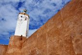 picture of fortified wall  - Walls of the Portuguese Fortified City of Mazagan Morocco with cloudscape at the background - JPG