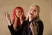 picture of gullible  - Happy woman singing loudly with annoyed teenager nearby - JPG
