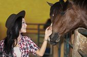 Beautiful Female Horse Rider In Ranch