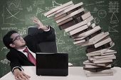 Stress Businessman With Falling Books At Class