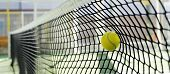 foto of paddling  - Tennis or paddle tennis ball impact the net