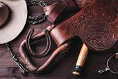 pic of spurs  - horse saddle leather and various equipment on background - JPG