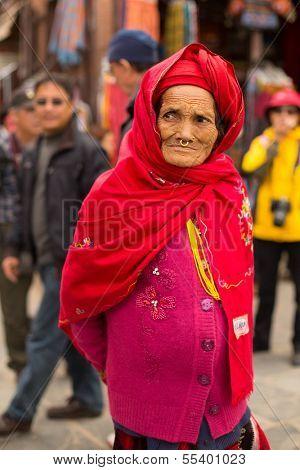 KATHMANDU, NEPAL - DEC 12: Portrait of unidentified old woman near stupa Boudhanath Dec 12, 2013 in Kathmandu, Nepal. Stupa is one of the largest in the world, of 1979 is a UNESCO World Heritage Site.