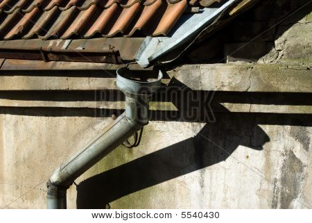 Old Rain Gutter With Drainpipe