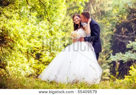 Wedding shot of bride and groom in park