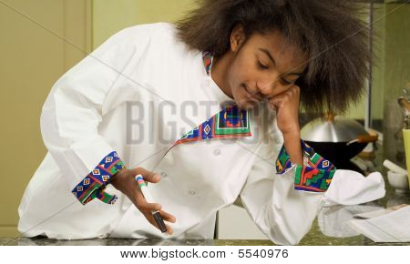 African American Chef Leaning On Elbow