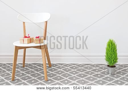 Presents On A White Chair, And Little Green Tree