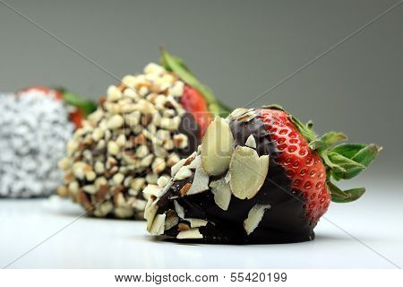 Chocolate coated strawberry with nuts