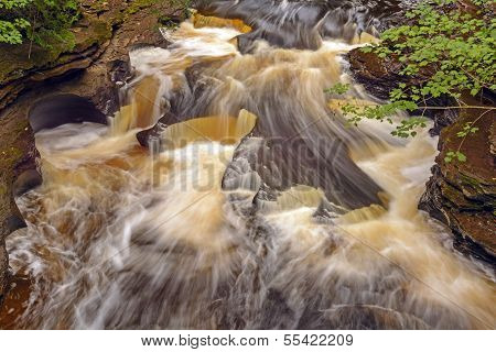 Swirling Waters On A Secluded River
