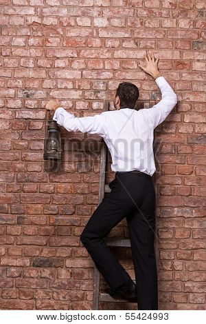 Man Up Against A Brick Wall