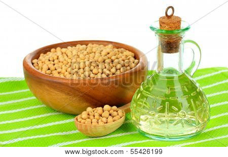 Soy beans and oil on table on white background