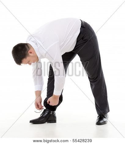 Man Bending Down To Do Up His Shoelaces