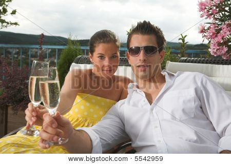 Stylish Couple Having A Drink On Terrace