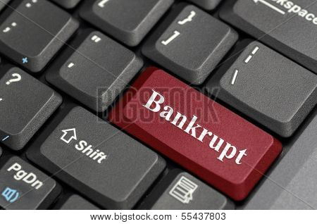 Red bankrupt key on keyboard