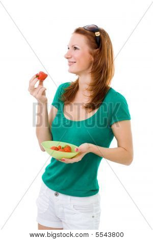 Woman Eating Strawberry And Smiling