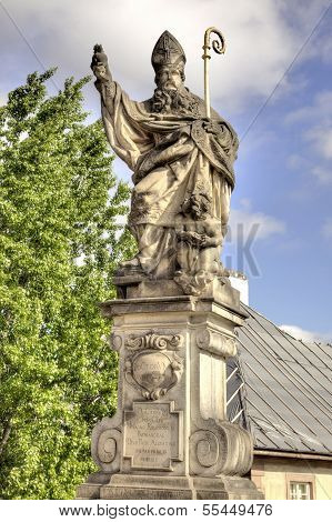 Ancient Sculpture On The Charles Bridge. Prague. Blessed St. Augustine Tramples Heretical Book. Hdr