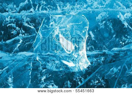 Transparent ice with cracks as a background for design