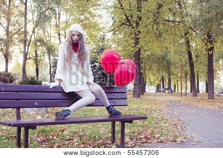 young girl walking in the autumn park