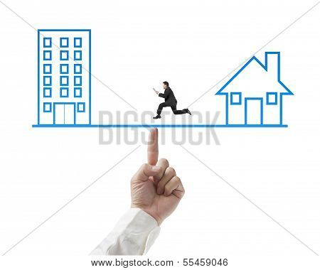 Businessman Running On Seesaw With Office And Home