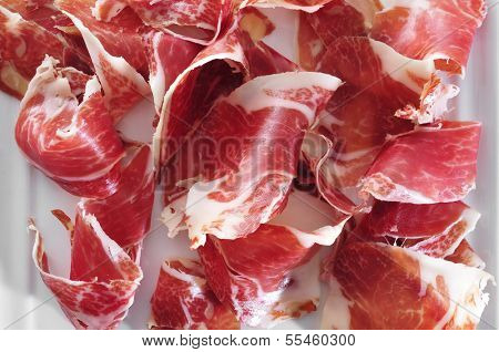 a plate with spanish serrano ham served as tapas