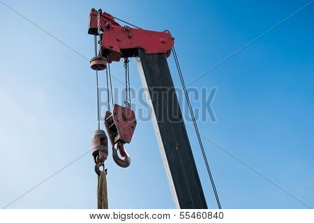 An Empty Crane In A Construction Site Under The Blue Sky