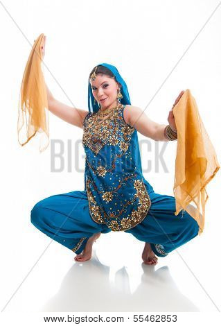 Bollywood dancer in traditional beautifu lblue dress performing with orange scarfs