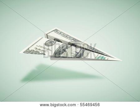Papierflugzeug dollar