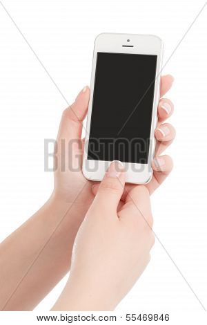 Female Hands Holding White Modern Smart Phone And Pressing Button By The Thumb