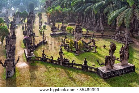 Buddha park in Vientiane, Laos. Famous travel tourist landmark of Buddhist stone statues and religious figures