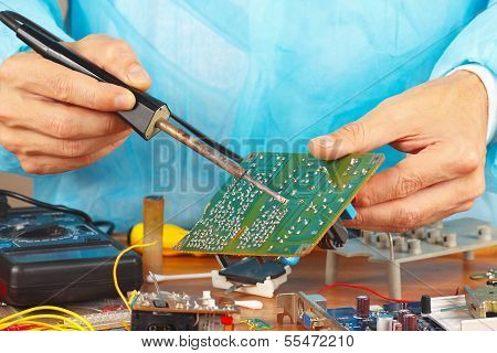 Soldering electronic board of device in service workshop