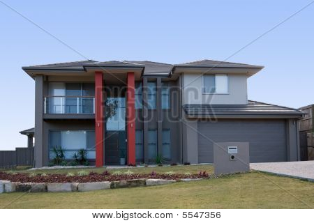 Modern Grey House With Red Pillars