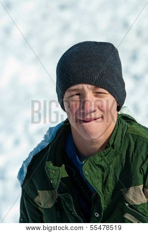 Teen Sitting In Snow