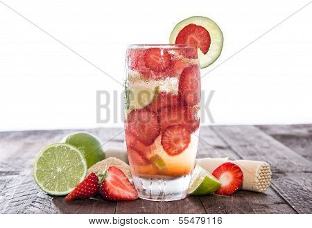 Strawberry Caipirinha On A Wooden Table Against White