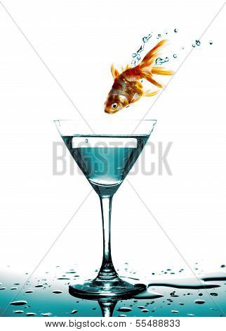 Jump Of Golden Fish To Martini Glass, White Background