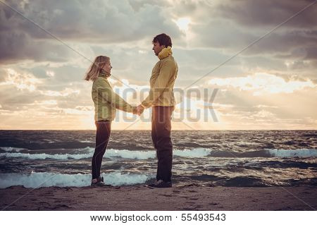 Couple Man And Woman In Love Standing On Beach Seaside Holding Hand In Hand With Beautiful Sunset Sk