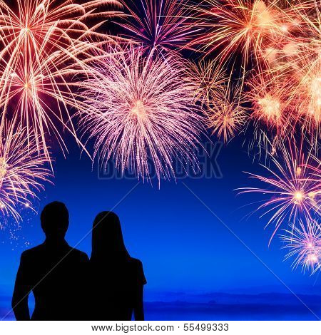 Couple Enjoying A Fireworks Display