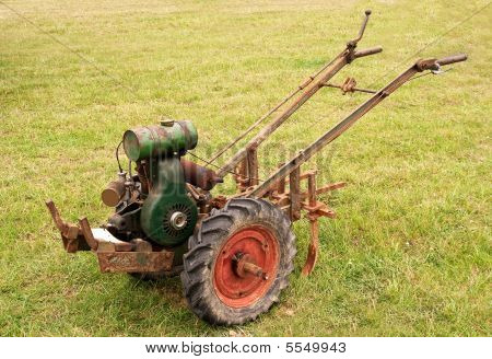 Old-fashioned Garden Tiller Or Rotovator