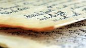 picture of scribes  - Calligraphy handwriting on old vintage paper closeup  - JPG