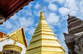 stock photo of cho-cho  - Golden Pagoda at Wat Phra That Cho Hae  - JPG