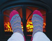 picture of stocking-foot  - A Pair of Feet Warming in Front of a Cozy Fireplace - JPG