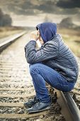 image of sorrow  - Sorrowful boy on the railway in autumn - JPG