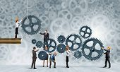 stock photo of partnership  - Conceptual image of businessteam working cohesively - JPG