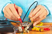 Master measures the parameters of the electronic device with multimeter