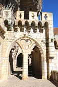 Mullioned window and arch in episcopal city of Rocamadour, France