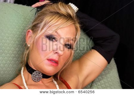 Blonde Woman In Make Up And Choker